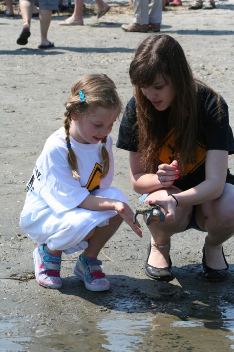 Kindergarten student releasing a terrapin she adopted