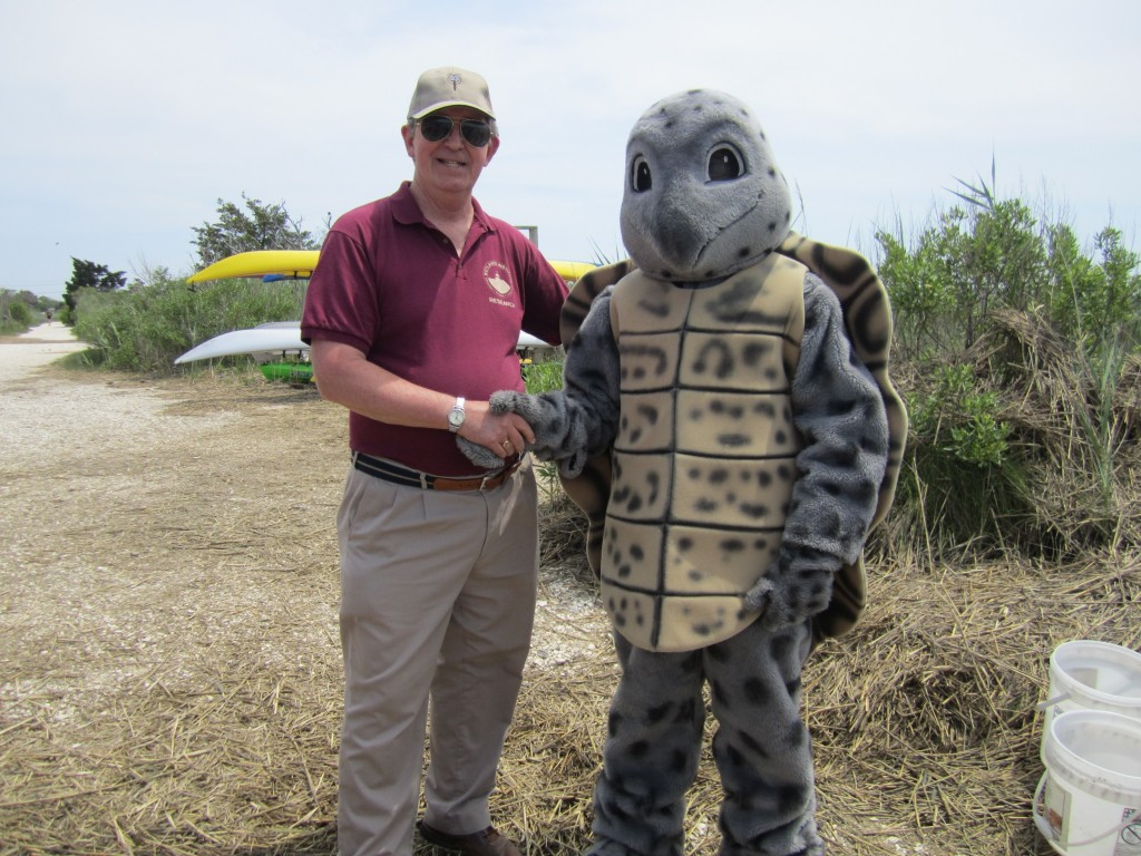 Director of Research, Dr. Roger Wood, shakes hands with Scute the Institute Terrapin
