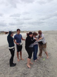 Students preparing to collect sand and water samples.